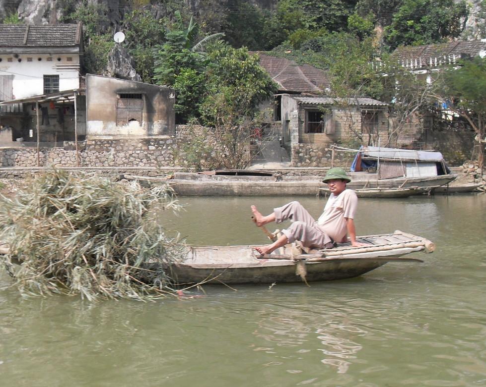 Rudertechnik mit Fuessen in Vietnam